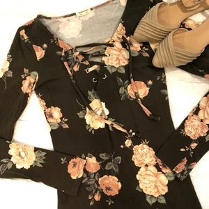 This is a pretty green and blush floral blouse